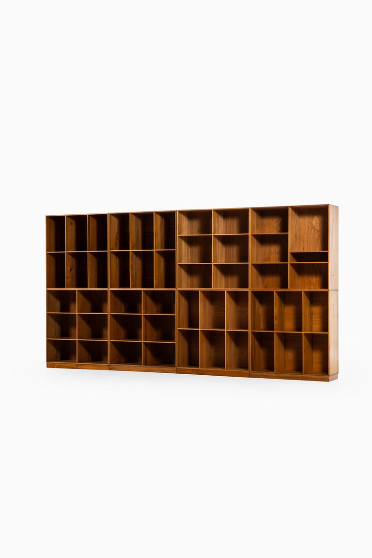 Set of 8 bookcases designed by Mogens Koch. Produced by Rud Rasmussen in Denmark.