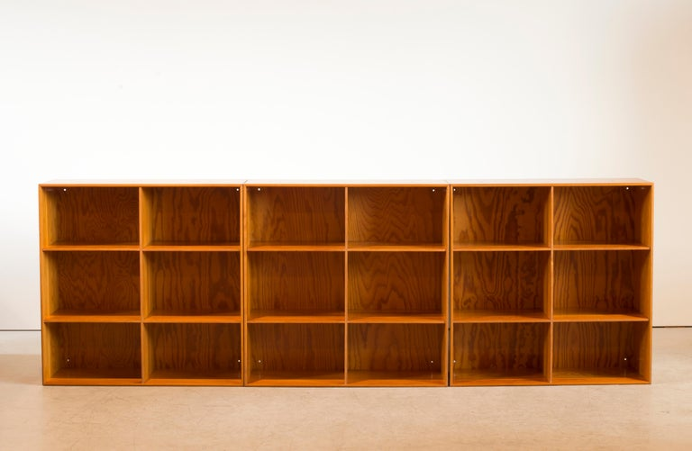 Mogens Koch set of four wall-mounted bookcases of pine. Executed by Rud Rasmussen.  Reverse with paper labels 'RUD. RASMUSSENS/SNEDKERIER/45 NØRREBROGADE/KØBENHAVN.