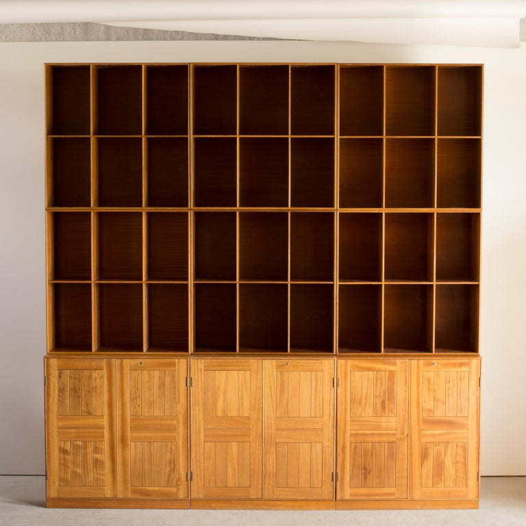 Mogens Koch library of mahogany. Three cabinets and six bookcases. Executed by Rud Rasmussen.  Reverse with paper labels 'RUD. RASMUSSENS/SNEDKERIER/KØBENHAVN/DENMARK.