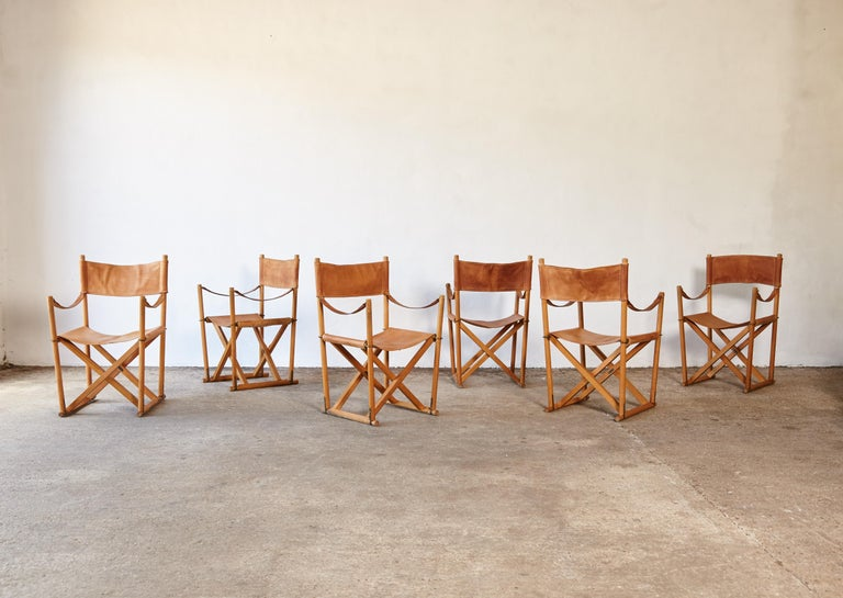 A stunning set of six rare leather Mogens Koch MK-16 folding safari chairs, produced by Rud Rasmussen, Denmark, 1960s. Originally designed in 1932 this chair wasn't produced commercially until the 1960s. The chair has a beech frame with a cognac