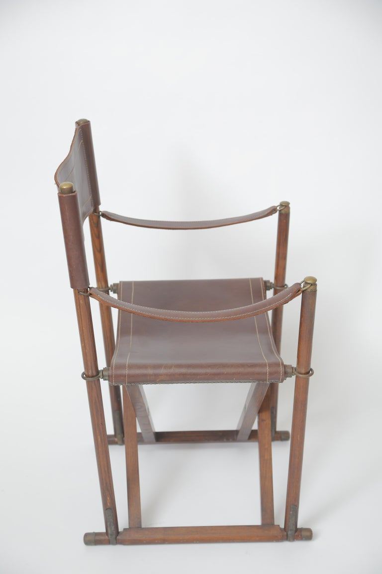 A beautifully executed campaign folding chair. Rosewood, brass and original leather.