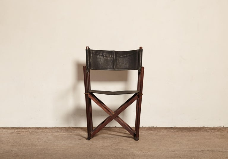 Mogens Koch MK-16 Safari chair for Interna, Denmark, 1960s. Originally designed in 1932 this chair wasn't produced commercially until the 1960s. The chair has a rosewood frame with black leather seat, backrest and armrests. With makers label