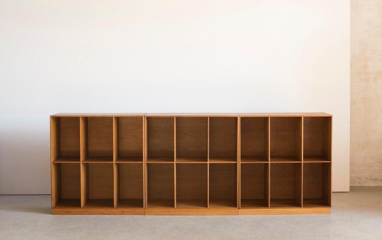 Mogens Koch set of three bookcases of oak. Executed by Rud Rasmussen.  Reverse with paper labels 'RUD. RASMUSSENS/SNEDKERIER/45 NØRREBROGADE/KØBENHAVN.