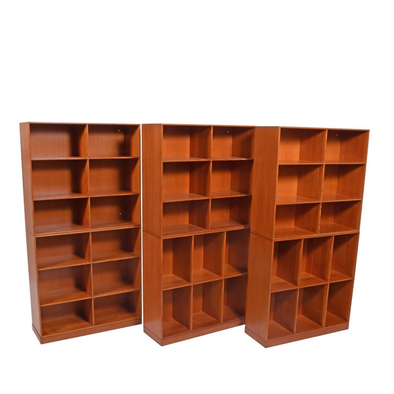 A Danish Classic. Solid Oregon pine, six open bookcases, all with manufacturing label on the back. Each bookcase is separate and can be rearranged as desired. Rud Rasmussen originally designed in the 1920s.  Measure: Each cabinet 29.75