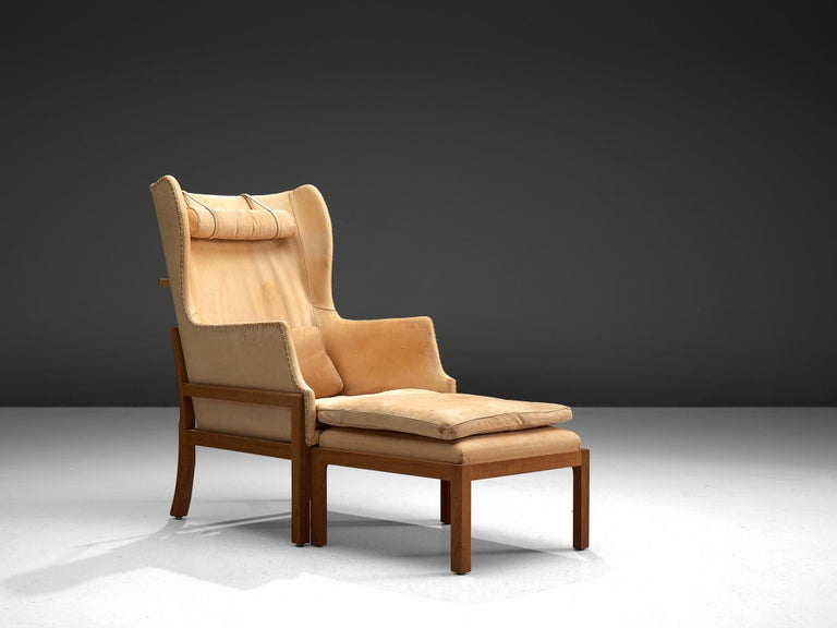 Mogens Koch for Rud Rasmussen, wingback chair and ottoman model MK50, mahogany and leather, Denmark, design 1936, manufactured 1964-1979.