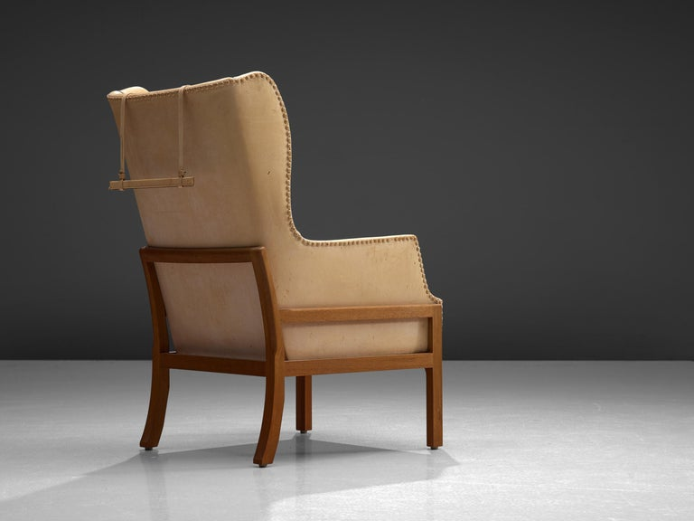 20th Century Mogens Koch Wingback Chair and Ottoman in Cognac Leather For Sale