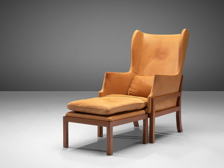 Mogens Koch for Rud Rasmussen, wingback chair and ottoman model MK50, mahogany, leather, Denmark, design 1936, manufactured 1964-1979  Mogens Koch's wingback chair is inspired by Kaare Klint's furniture design, which in turn is inspired by English