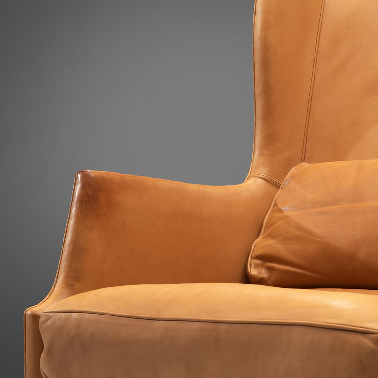 Mid-Century Modern Mogens Koch Wingback Lounge Chair and Ottoman in Cognac Leather For Sale