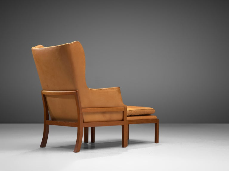 Danish Mogens Koch Wingback Lounge Chair and Ottoman in Cognac Leather For Sale