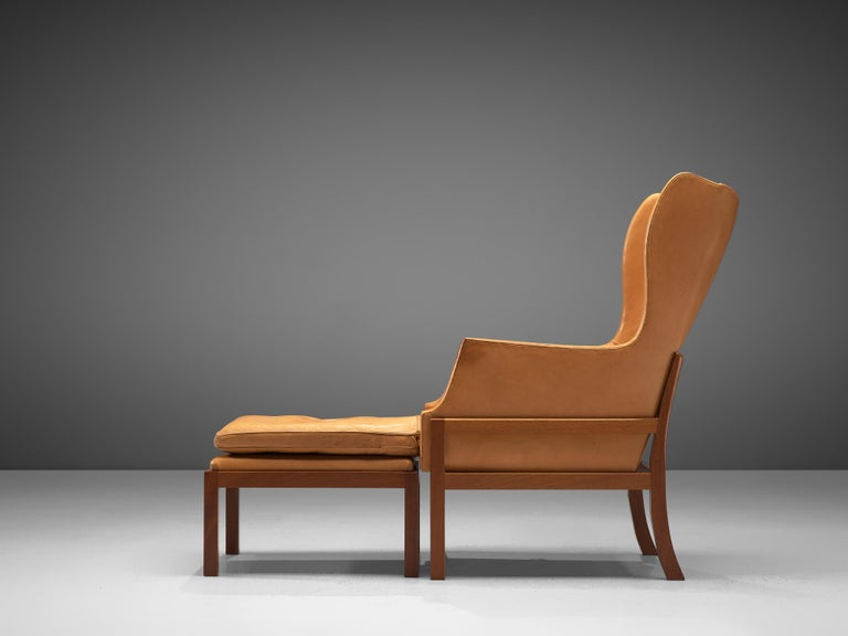 20th Century Mogens Koch Wingback Lounge Chair and Ottoman in Cognac Leather For Sale