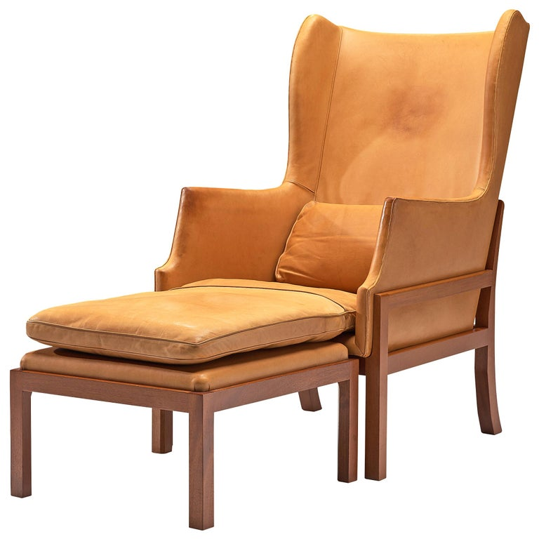 Mogens Koch Wingback Lounge Chair and Ottoman in Cognac Leather For Sale