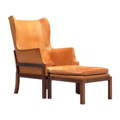 Mogens Koch Wingback Chair and Ottoman in Dark Mahogany, Cognac Leather