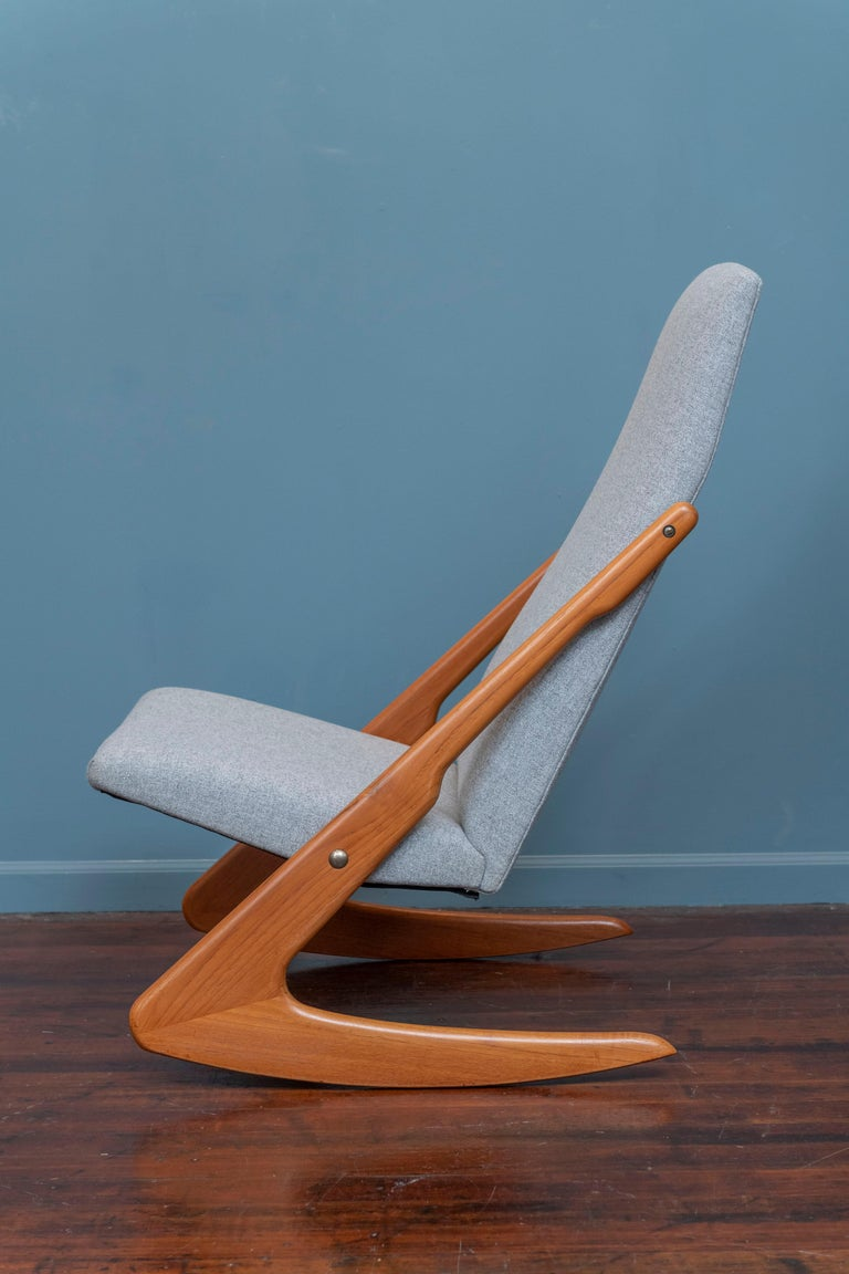 Mogens Kold design teak rocking chair, Denmark. Newly refinished and upholstered in a light grey wool, ready to rock!