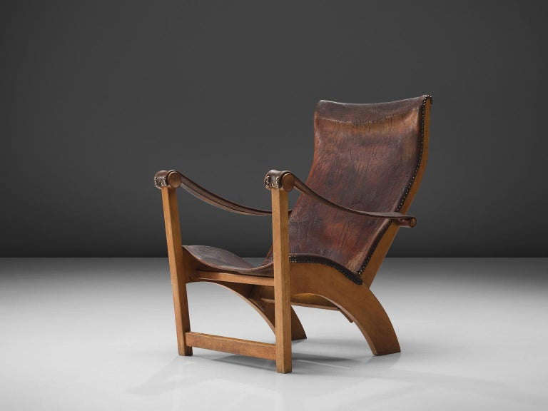 Mogens Voltelen for cabinetmaker Niels Vodder, lounge chair model 'Københavnerstol', beech, brown leather, Denmark, 1936  This Copenhagen lounge chair is designed by Mogens Voltelen. Classic early edition in which the armrests are attached to the