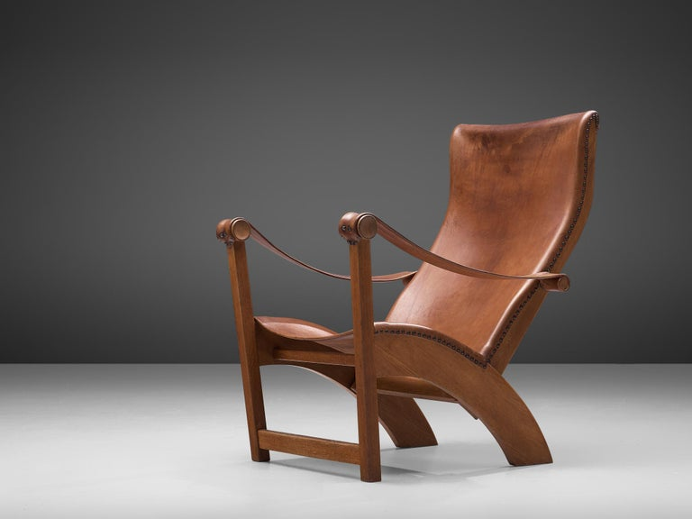 Mogens Voltelen for cabinetmaker Niels Vodder, lounge chair model 'Københavnerstolen', beech and cognac leather, Denmark, 1936.   This Copenhagen lounge chair is designed by Mogens Voltelen. Classic early edition in which the armrests are attached