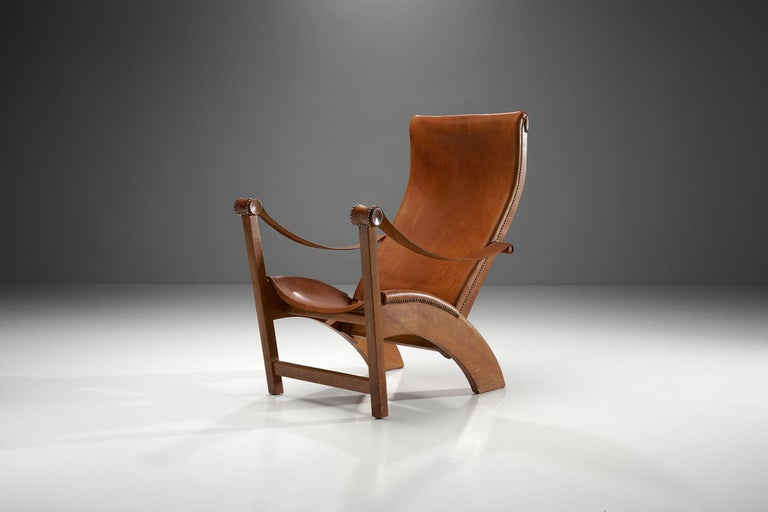 """This """"Københavnerstolen"""" (Copenhagen Chair) is Mogens Voltelen's most famous design. This particular model is from an early edition, which can be observed in the armrests that are directly attached to the sides of the backrest.  The sweeping"""