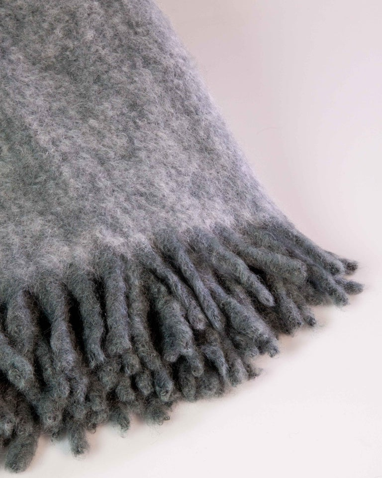 Mantas Ezcaray was founded in 1930 in La Rioja, Northern Spain, by Cecilio Valgañón, who transformed the hand loom processes of turning woolen cloth into handkerchiefs, scarves, shawls and blankets. Their master craftsmen use only the best natural