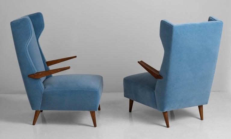 Newly upholstered in blue mohair by Maharam, on original teak frame.