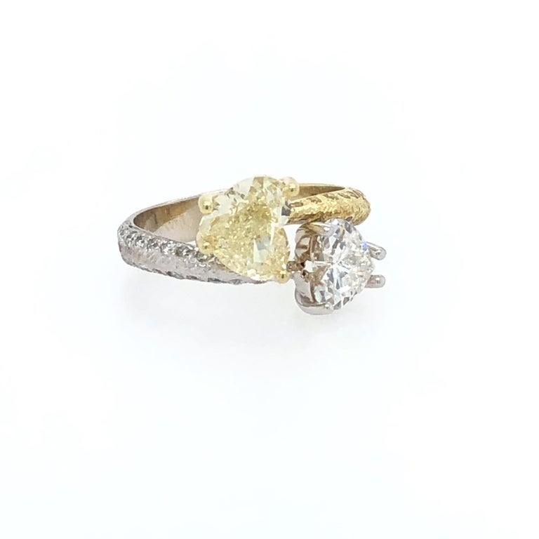 Offered here is a beautiful Moi et Toi double heart diamonds set in two ( 2 ) tone 18kt gold. The ring is a size 6.5 that may be sized. The ring weighs 4.7 grams and the top measures about 11 x 15.2 mm with the bottom shank measuring 3.8 mm. The