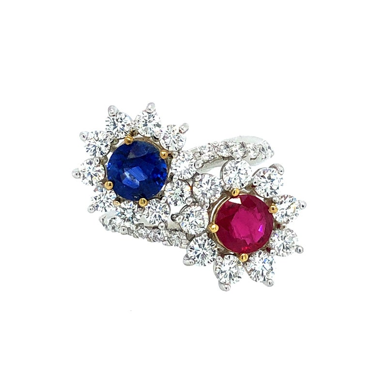 Offered here is a unique Moi et Toi diamond ring. The ring is 18kt white gold with two ( 2 ) 18kt yellow gold settings for the two gems ruby and sapphire. The ring is marked 18k and weighs 7.90 grams, ring size is 6.5 that can be sized. The ring