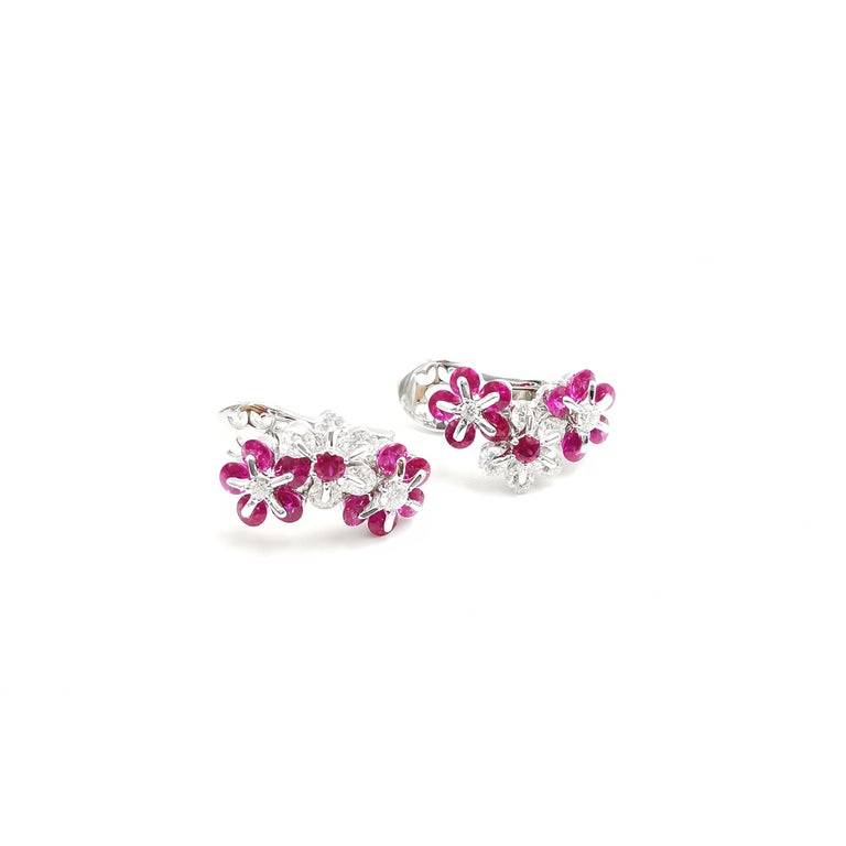 Diamonds and precise cut rubies are mounted in delicate flower design, employed innovative technology.  Internationally patented, Waltzing Brilliance technology is an innovative jewellery invention patented by a leading Russian designer, Viktor