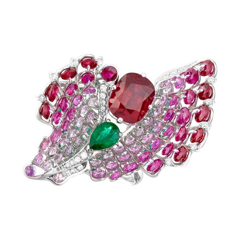 2.65ct Ruby is turned into a gorgeous and mysterious butterfly. Designed in Waltzing Brilliance jewellery technology, the butterfly captivated by the radiance of diamonds, emeralds,  graduation of pink sapphires and three dimensional design, and
