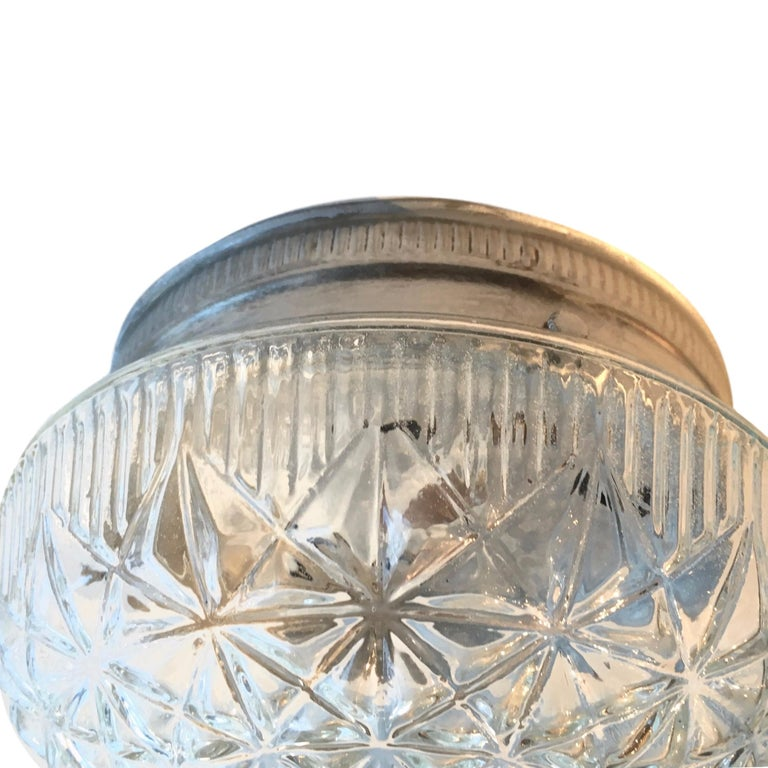 A circa 1950s French molded glass flush-mount light fixture.