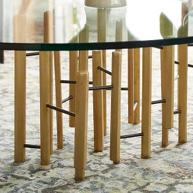 Shown in glass top with smooth brass hexagon shaped metal rods. The molecular cocktail table by Bradley Bayou home can be customized.