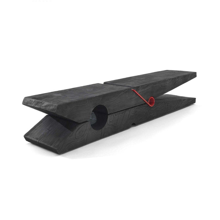 Bench made from a single block of aromatic cedar. Features a sculptured design that experiments with the classic Pop Art off-scale approach. Available in three different sizes: Mollettina, Molletta Medium and Molletta. The products are made from