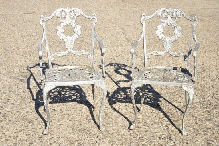 Molla antique French Victorian cast aluminum garden patio Bistro dining set - 3 piece set. Set includes (2) armchairs, (1) round table, cast aluminum construction, leafy scrollwork design, very nice vintage set, circa mid-20th century. Measurements: