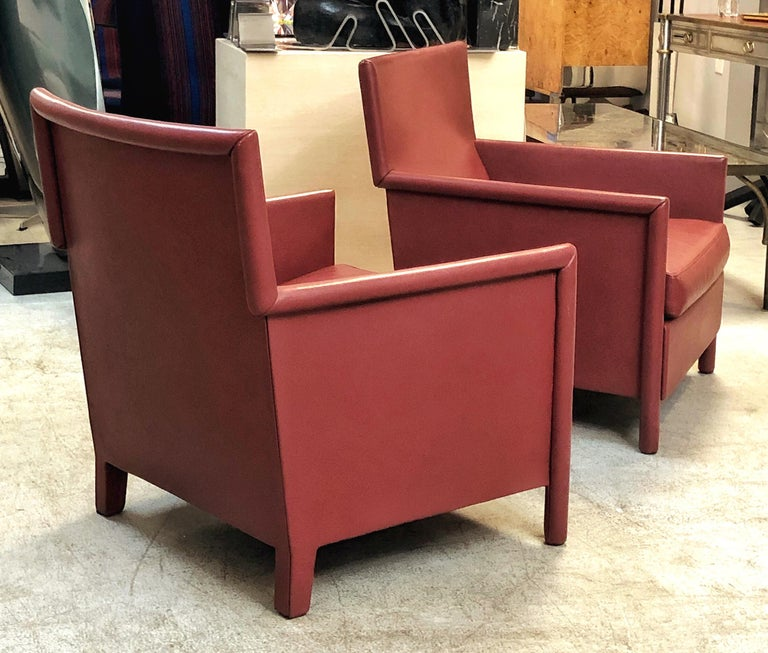 A pair of lounge chairs by Molteni. Down cushions, the whole frame is meticulously wrapped in leather.