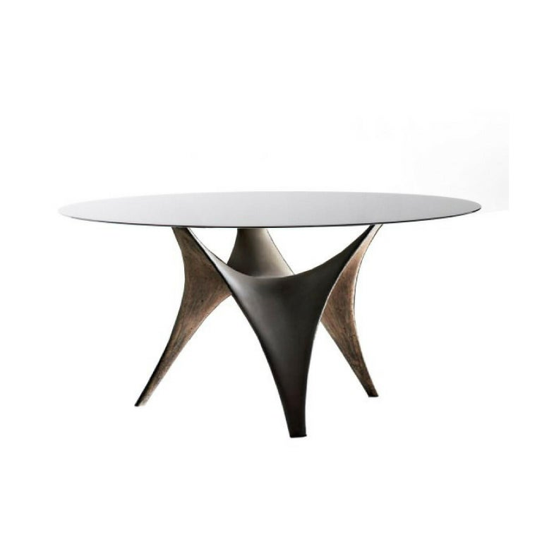 """The table Arc embodies the innovative concepts which distinguish it. The base shape is inspired by the techno structures currently used in modern building: a new """"light"""" cement which mixes color and a special fibrous material obtaining resistant"""
