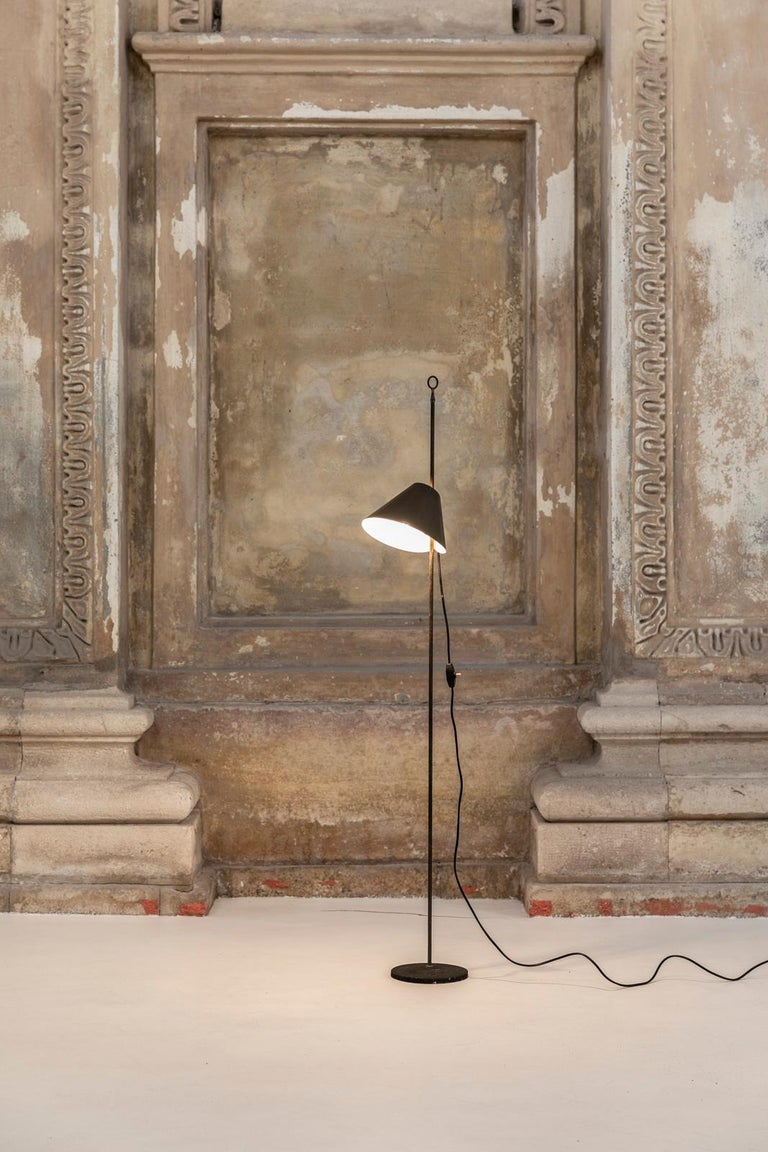 Iconic lamp designed by Luigi Caccia Dominioni for Azucena in 1953. The Monachella lamp takes its name from the black veil worn by nuns because at that time Caccia Dominioni was working on the Convent and Institute of the Beata Vergine Addolorata in