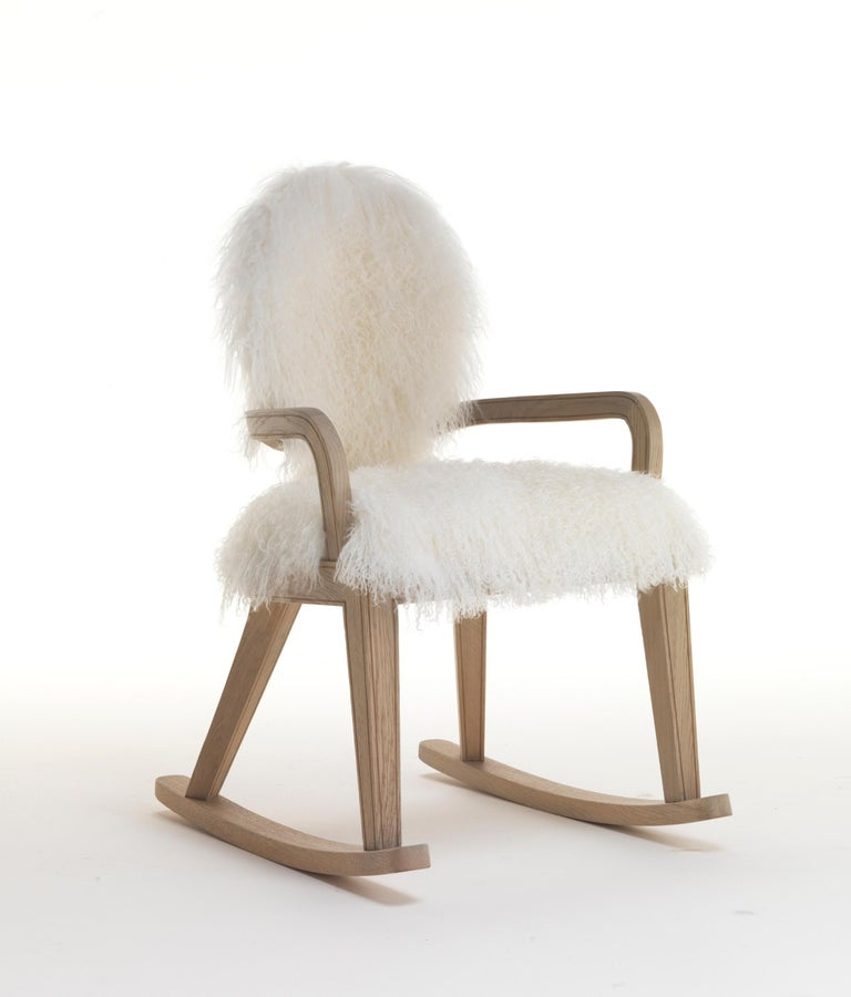 This rocking chair is with arms, frontal back covered with white lamb, decorated wooden outside, back upholstered seat covered with white lamb.  Dimensions: Dia. 54 W x 66 D x 92 H cm, SH 47 cm.  This item has been individually handmade by our