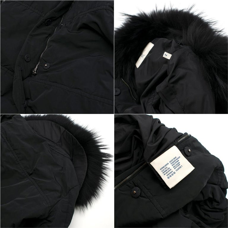 Moncler Black Down Coat with Fur Collar  - Padded down coat  - Functioning pockets - Detachable fur collar; authentic raccoon fur - Functioning zipper and fabric-covered buttons  Please note, these items are pre-owned and may show signs of being