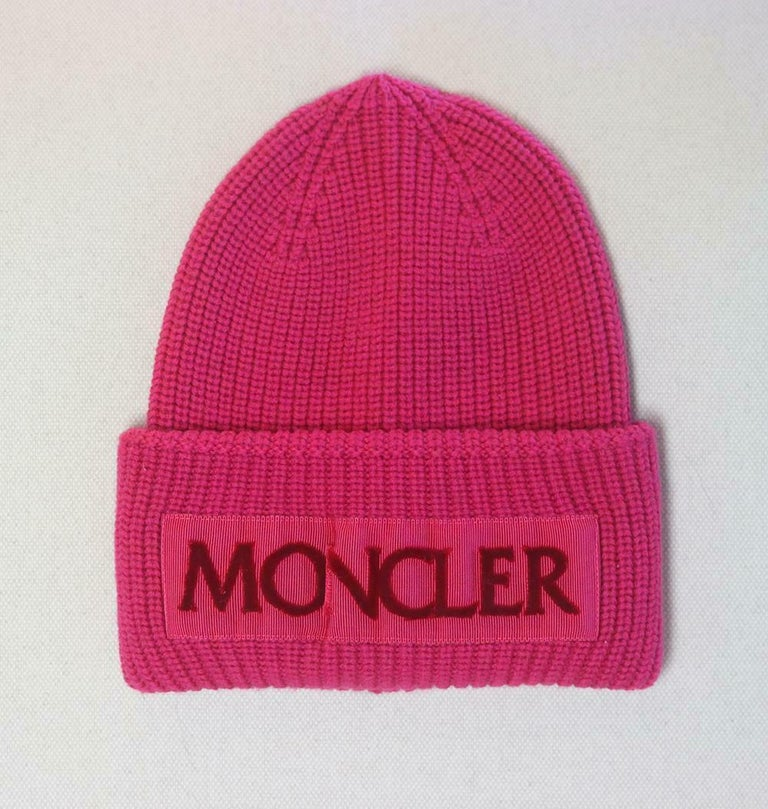 Moncler's bright pink-beanie features the label's logo flocked across the grosgrain ribbon trim, it's made from pure wool in a reassuring chunky knit, so you'll stay warm no matter how cold it gets. Bright-pink wool and grosgrain. Slips on. 100%