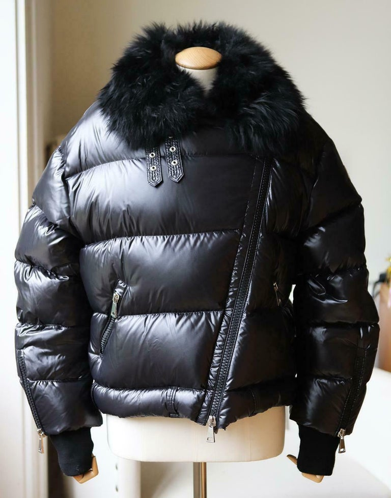The brand uses the same techniques today for pieces like this jacket, which is cut from patent-shell and quilted to ensure optimum warmth. It has a plush shearling collar and an asymmetric two-way zip fastening through the front. Black patent-shell