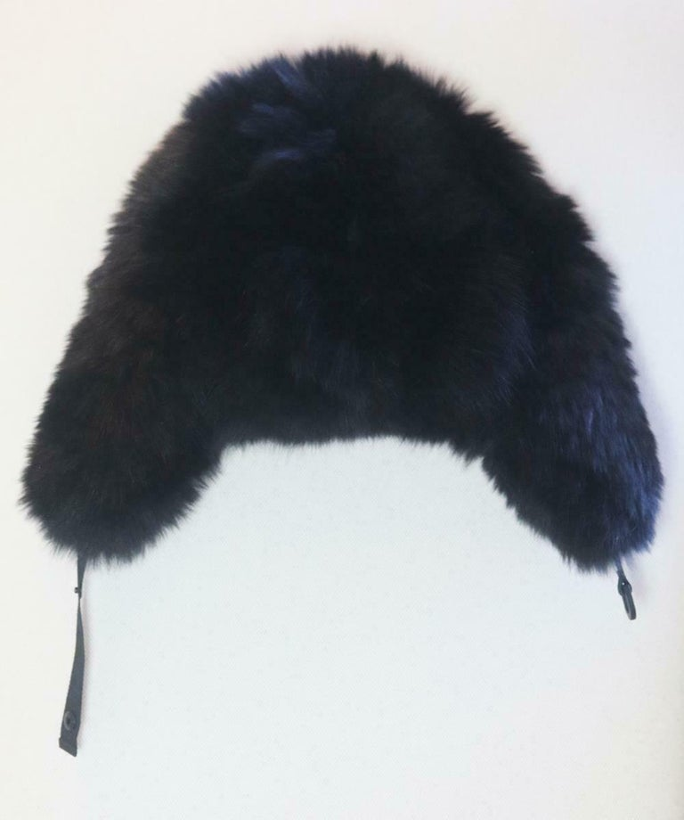Moncler presents a high-fashion take on a cold-weather essential with this luxe trapper hat, the plush black fox-fur makes a fashionable statement while keeping ears warm in a stylish trapper hat designed. Black fox fur, black nylon. Snap fastening