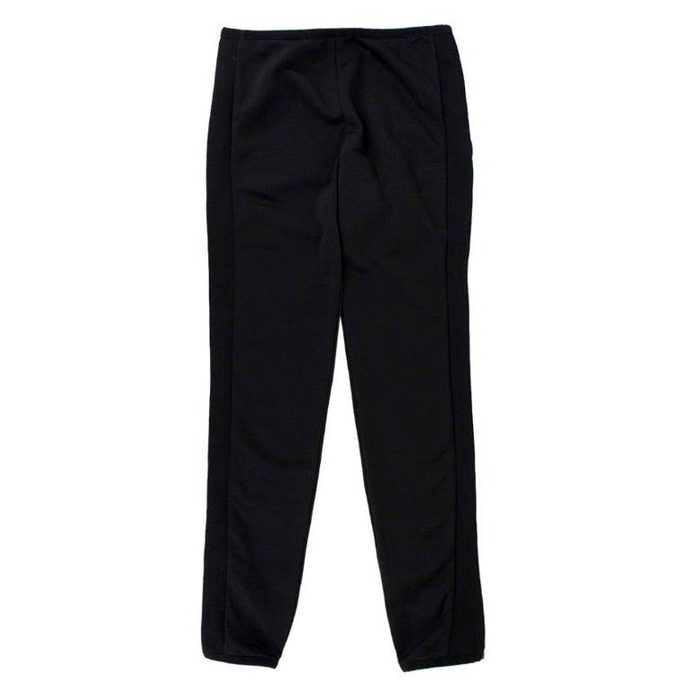 Moncler Ribbed Skinny Trousers  - Stretch fabric - Elastic waistline and hem - Ribbed side panels - Tight-fit - Signature logo tag at back waistline  Please note, these items are pre-owned and may show some signs of storage, even when unworn and