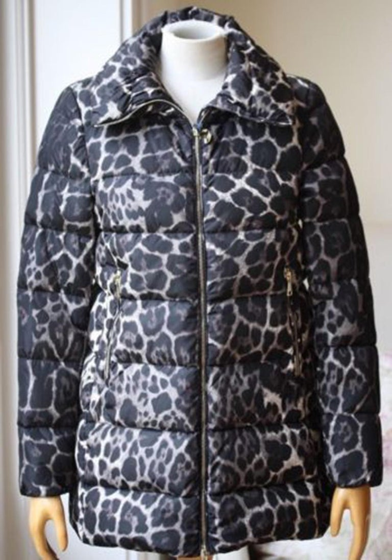 Leopard print down coat from Moncler featuring long sleeves, elasticated cuffs. Self: 100% polyamide. Filling: 90% down 10% feather. Made in Bulgaria. Dual zip front closure. Side zip pockets. Colour: black.   Size: 1 (UK 8, US 4, FR 36, IT
