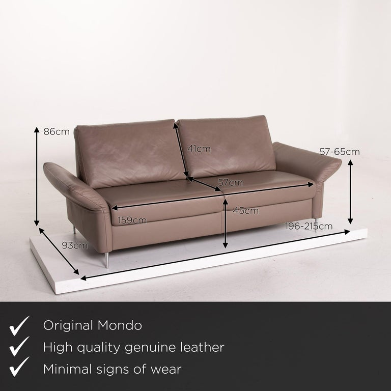 We present to you a Mondo leather sofa beige three-seat function couch.      Product measurements in centimeters:    Depth 93 Width 215 Height 86 Seat height 45 Rest height 65 Seat depth 57 Seat width 159 Back height 41.