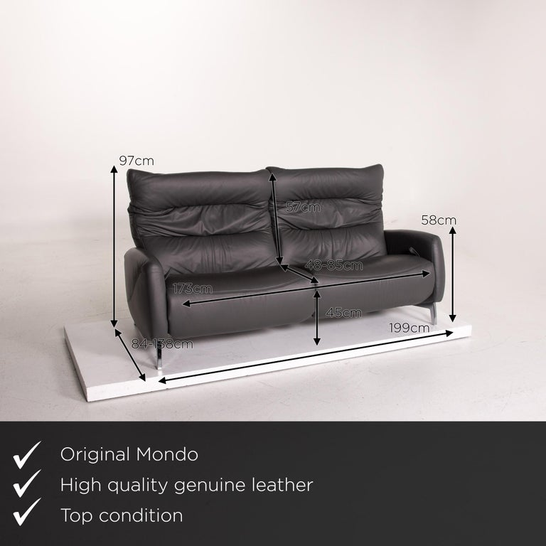 We present to you a Mondo Recero leather sofa gray two-seat function relax function couch.       Product measurements in centimeters:    Depth 84 Width 199 Height 97 Seat height 45 Rest height 58 Seat depth 48 Seat width 173 Back
