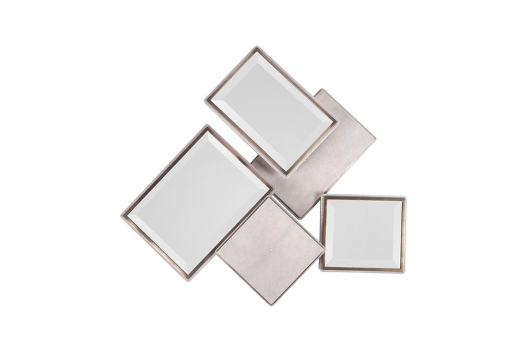 The Mondrian Mirror Large is a playful graphic piece with it's geometric mixture of mirror parts and cream shagreen parts that are placed on different levels. The shagreen parts have a discreet metal indentation detail adding another element of