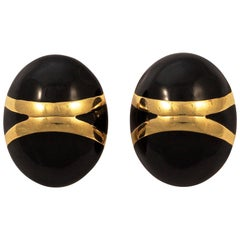 Monet Oval Gold Tone and Black Enamel Clip On Earrings circa 1980s