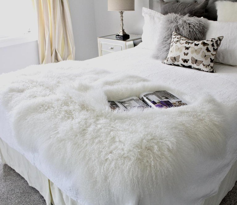 Living with this Mongolian fur throw rug will add luxurious and decadent styling to your decor. Whether you looking for a fluffy fur rug for a small area space or a real fur throw for the sofa or bed, this natural white fur throw rug is versatile in