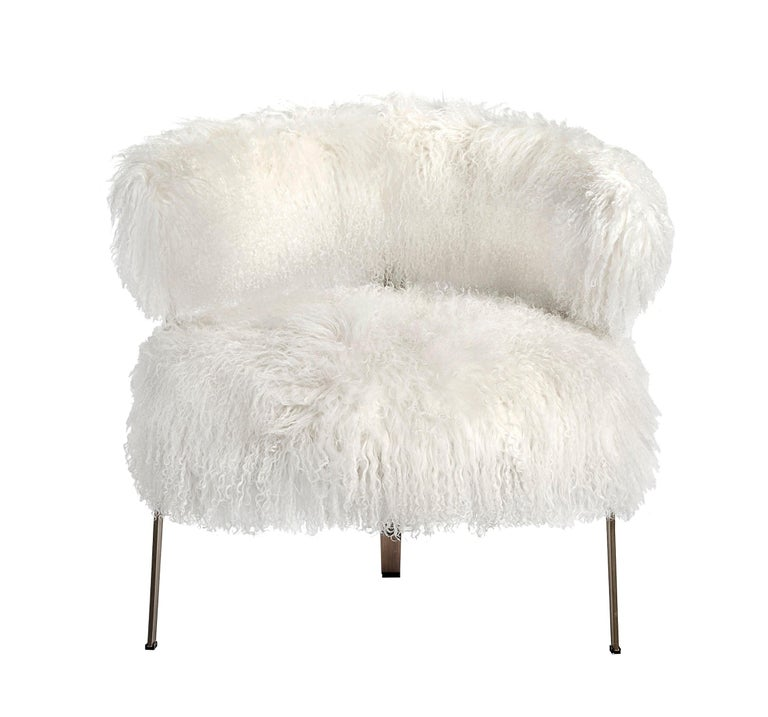 This playful lounge chair features a stainless steel frame in an antique bronze finish paired with a long curly premium-grade sheepskin seat in white. 