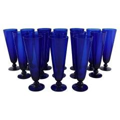 Monica Bratt for Reijmyre, 15 Champagne Flutes in Blue Mouth Blown Art Glass
