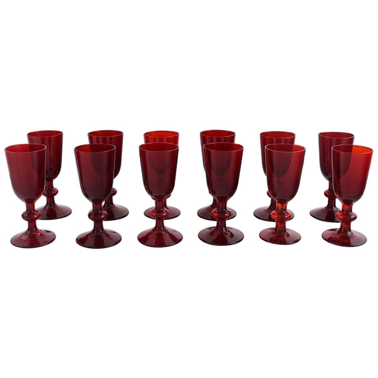 Monica Bratt for Reijmyre, Twelve Liqueur Glasses in Red Mouth Blown Art Glass