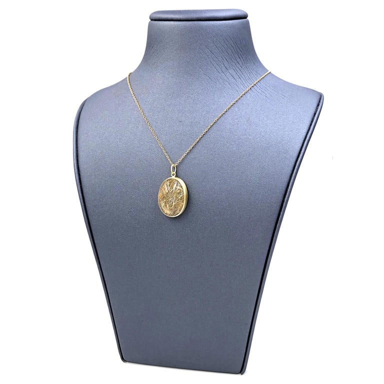 One of a Kind Drop Necklace handcrafted by jewelry artist Monica Marcella featuring a phenomenal golden rutilated quartz cabochon bezel-set in matte-finished 18k yellow gold  and attached to an 18 inch long 18k yellow gold link chain. Stamped 750.