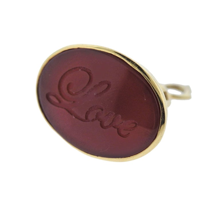 18k yellow gold fob pendant, crafted by Monica Rich Kosann, featuring carnelian intaglio,  reading